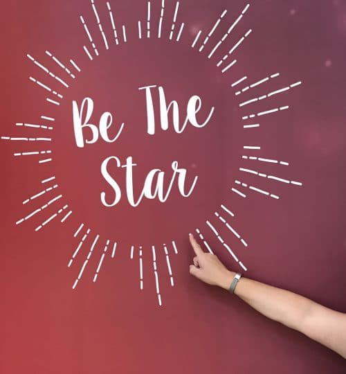 Image with a finger pointing to the words Be the Star